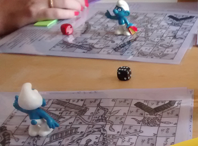 Plot-layering snakes and ladders boards with smurfs