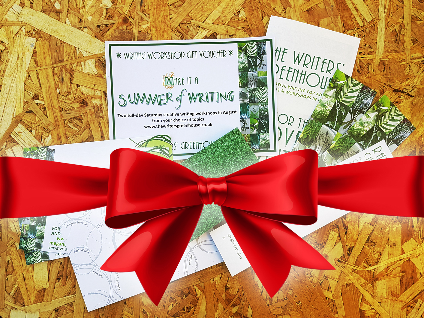 Photo of voucher with rhyme bookmarks, Story Circle postcards, and a small green notebook